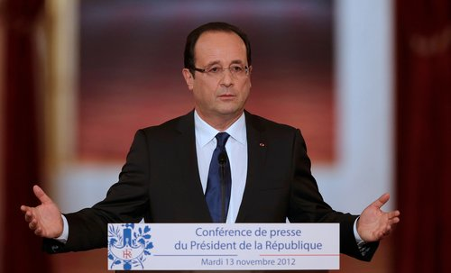 France's President Hollande addresses a news conference at the Elysee Palace in Paris